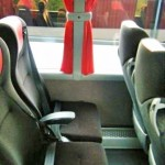 Touring Bus with reclining seats and arm rests